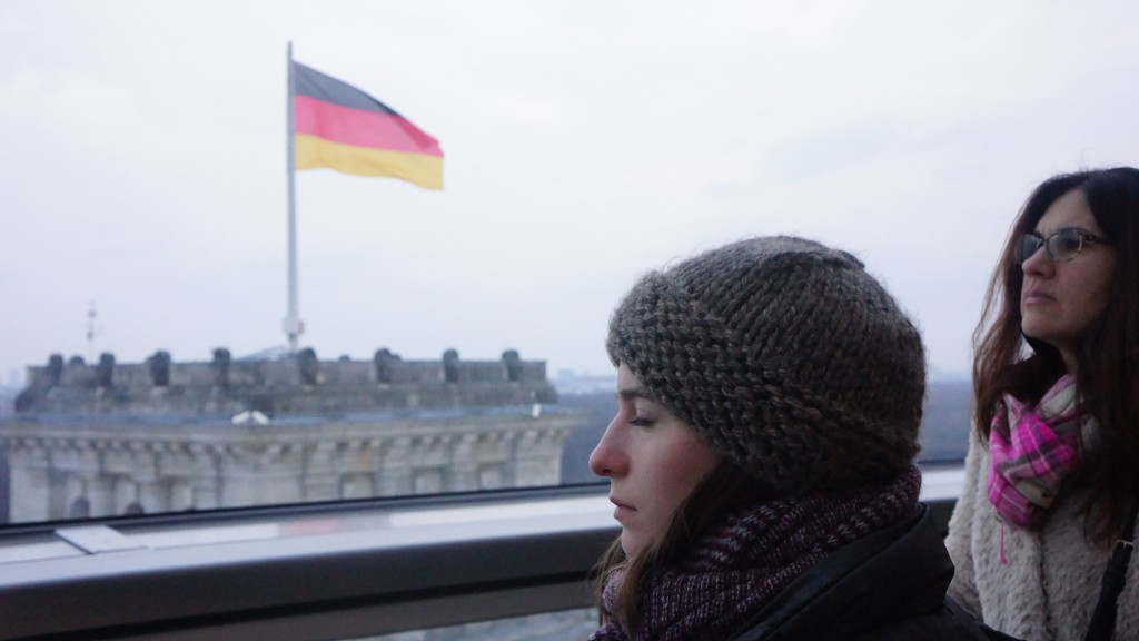 Hannah Grace and Kyra in the Reichstag dome, German flag in the background.