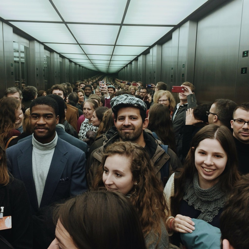 "The group packed into a mirrored elevator in the Bundestag, on our way to the Green Party's conference rooms. When this image was shared on our class whatsapp group text, Caroline B. captioned it ""Dr. Zamir caught smiling."""
